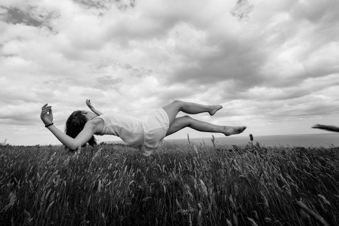 Levitating woman in a corn field