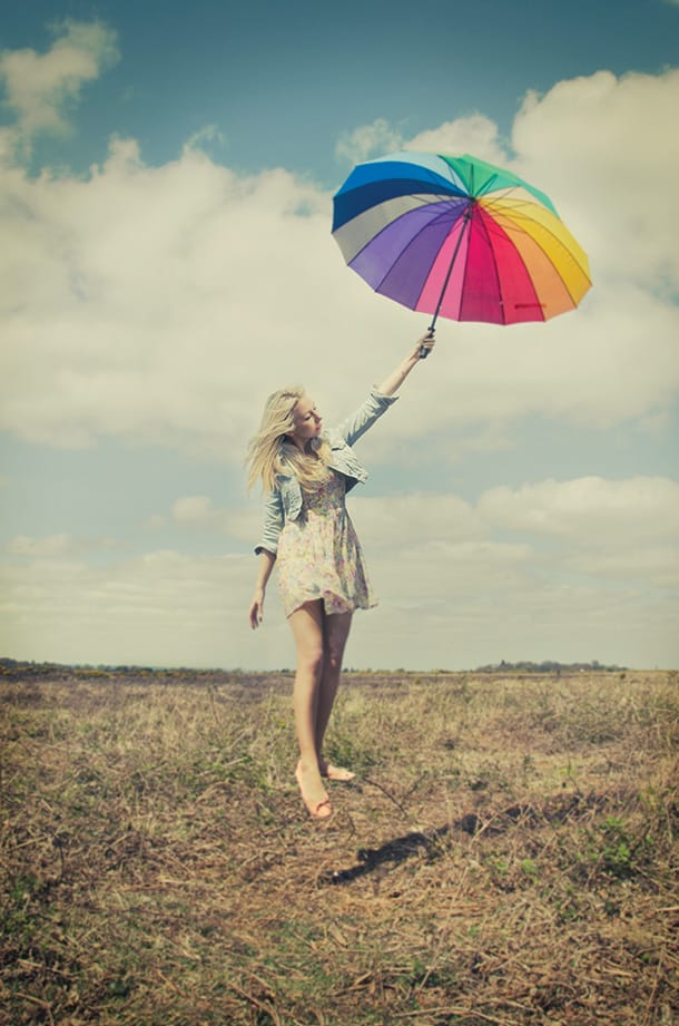 Levitating woman with rainbow umbrella