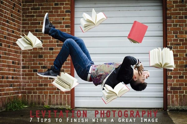 Levitating young man with books around him
