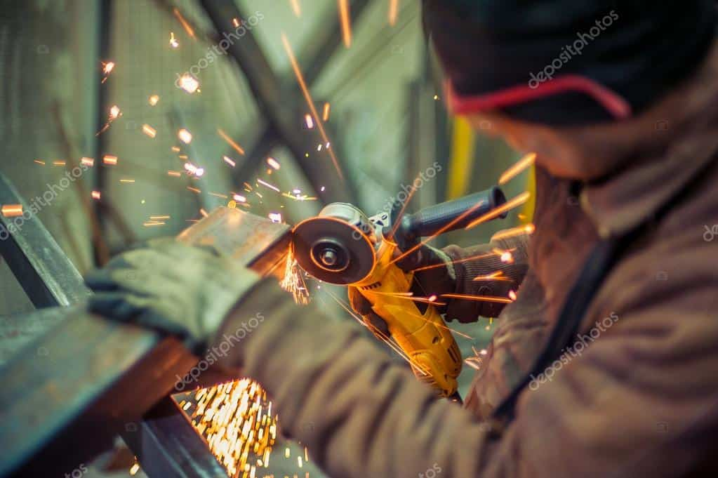 Working man cutting metal